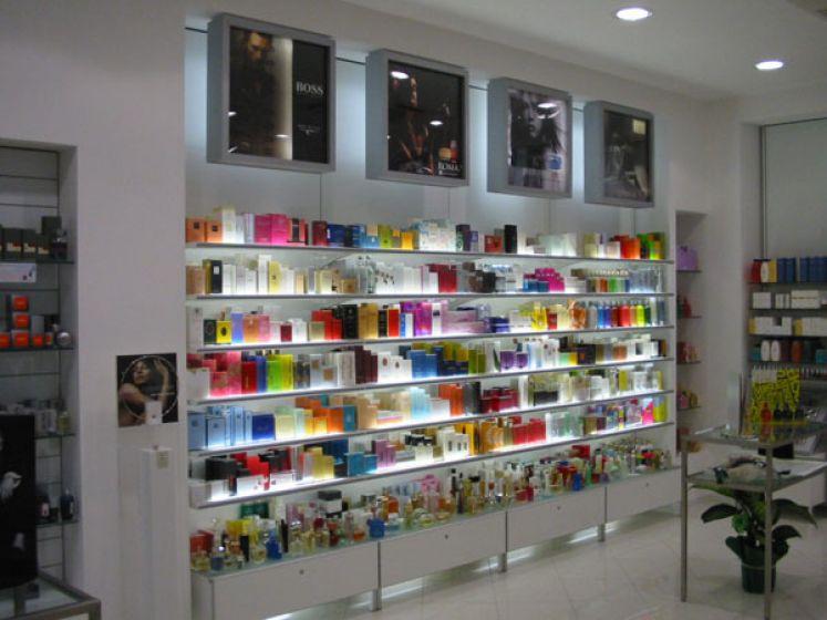 Portella equipaments perfumeria equipamiento integral - Estanterias para perfumerias ...