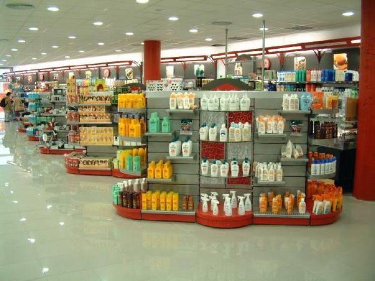 Portella equipaments farmacia equipamiento integral - Estanterias para perfumerias ...
